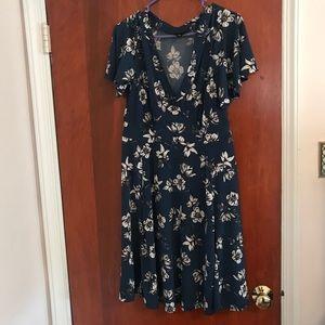 Blue floral wrap dress. This dress is a m/L
